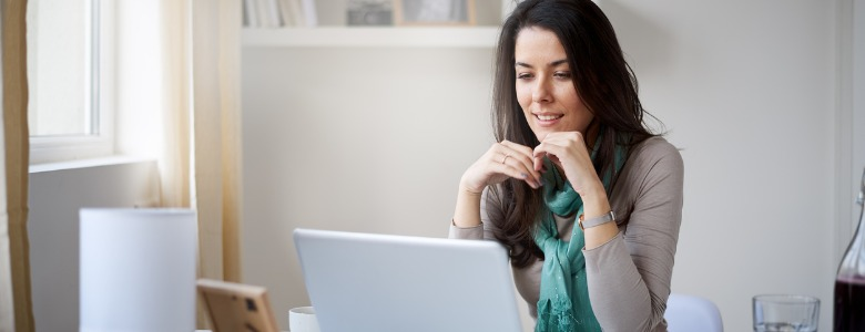 businesswoman-working-on-laptop-from-home