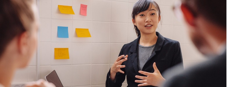 female-executive-explaining-new-business-idea-to-colleagues-picture-id607281552.jpg