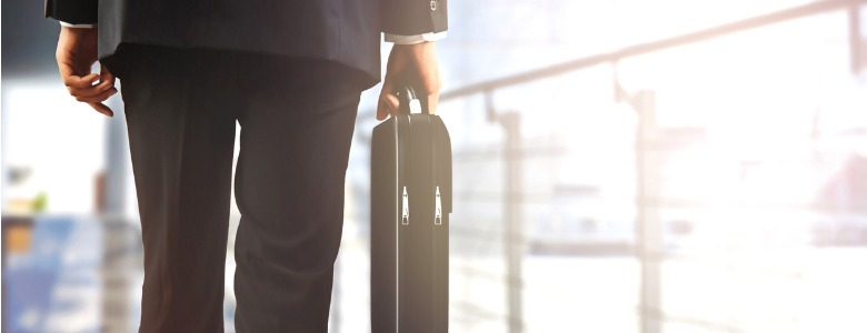 business-travellers-walking-in-airport-with-luggage-picture-id502041462