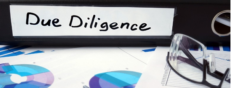 graphs-and-file-folder-with-label-due-diligence-picture-id470442150